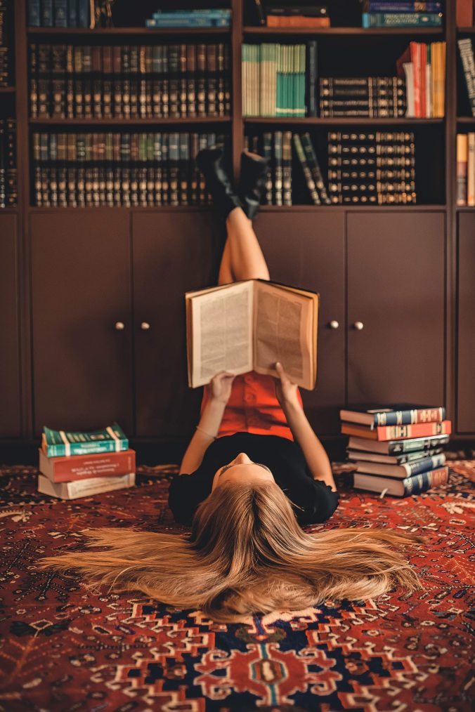 woman-lying-on-area-rug-reading-books-2899918.jpg