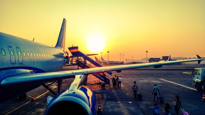 photography-of-airplane-during-sunrise-723240